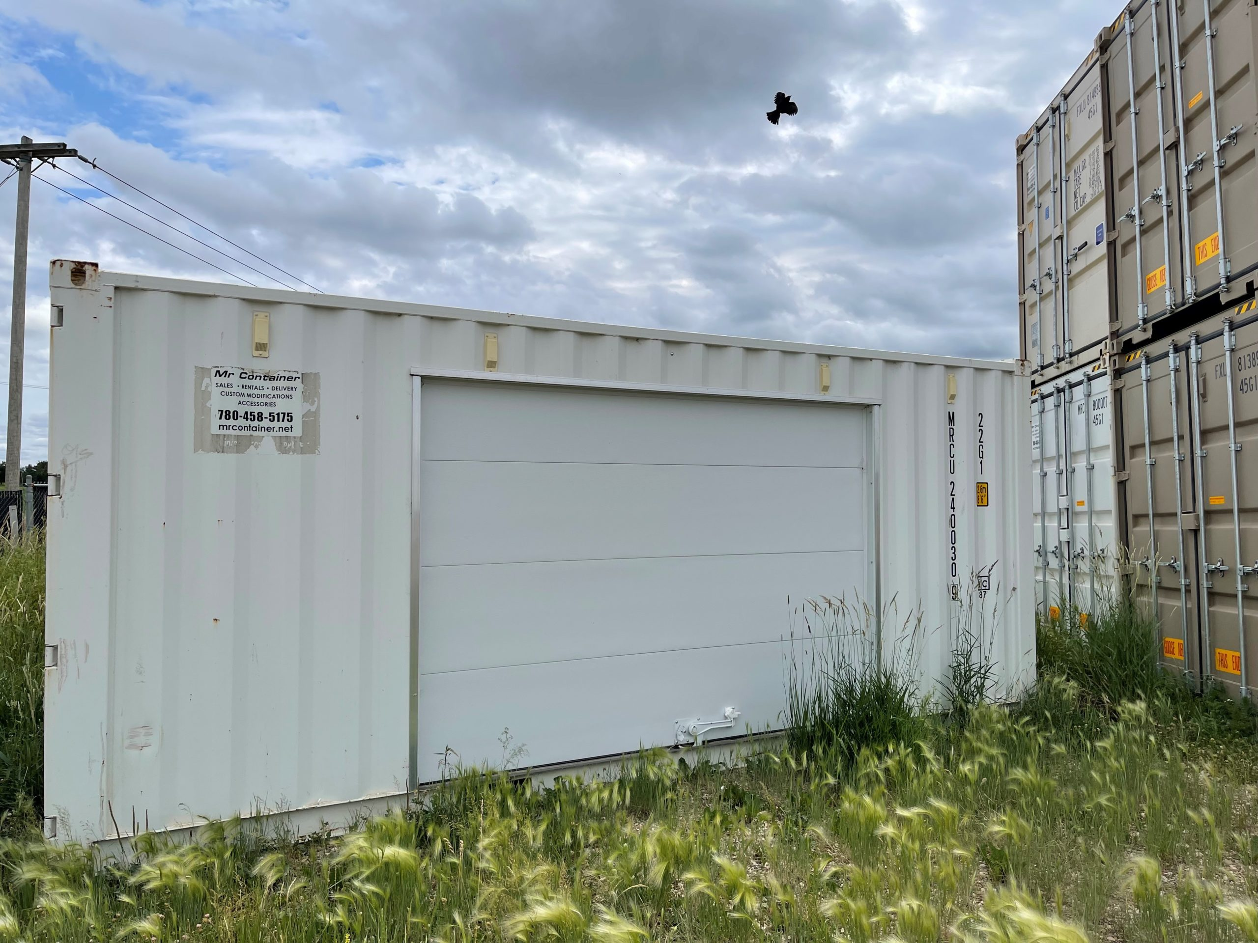 20' New (1-TRIP) Shipping Container + Overhead Garage - Custom Cubes